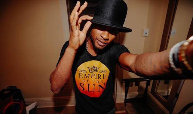 Usher Wearing Empire of the Sun T-Shirt