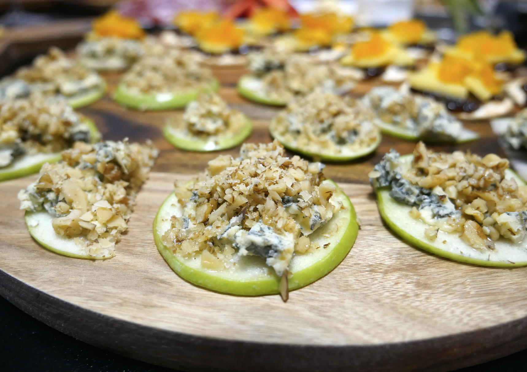 Combo #5 Blue Cheese and a walnut crumb on a thinly sliced apple all drizzled with honey